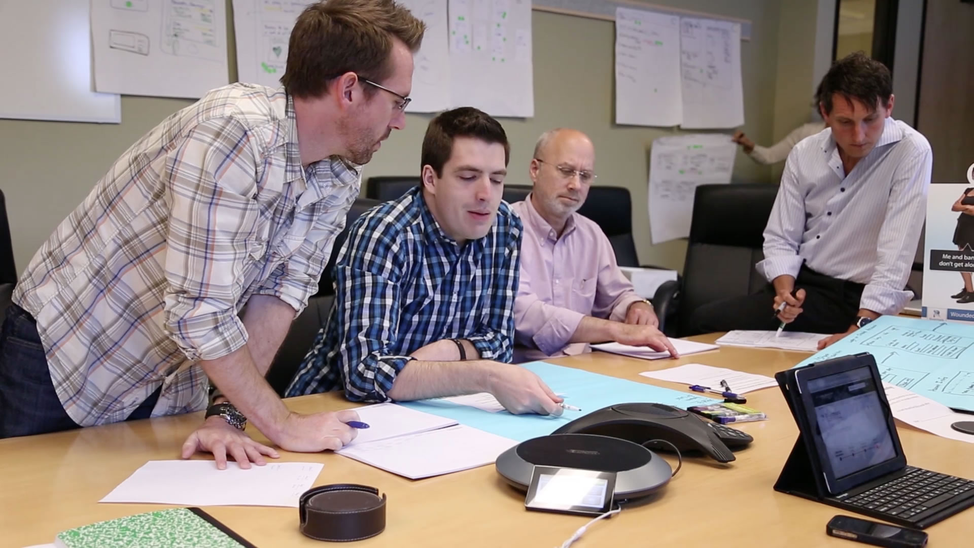 People discussing at a conference table