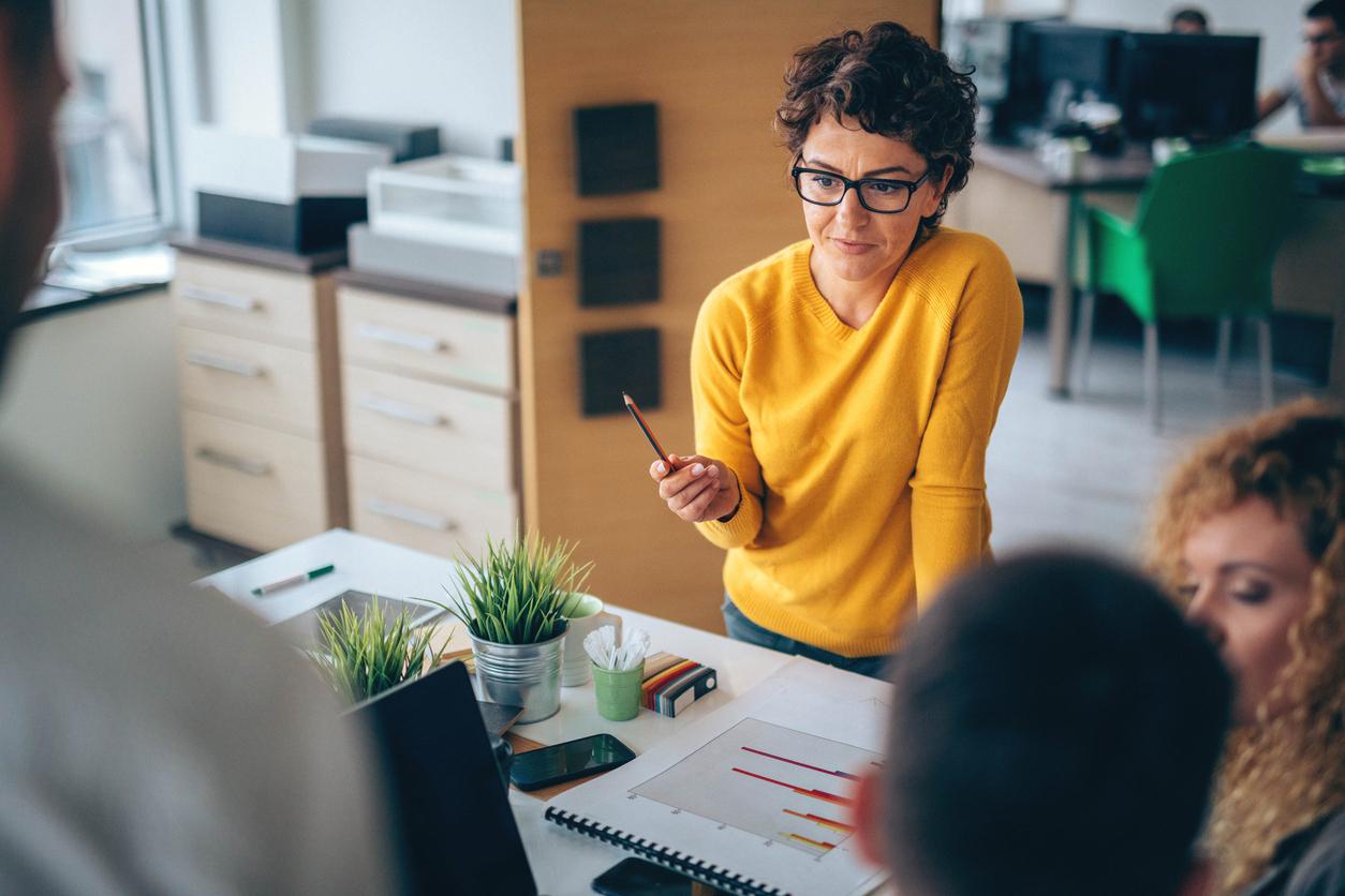 UX manager standing at design desk