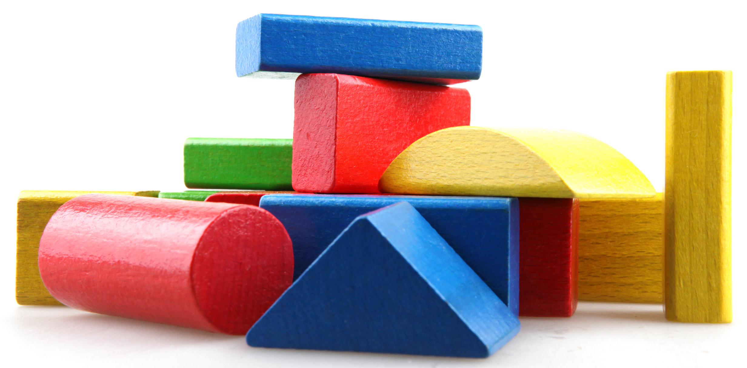 wooden blocks laying in semi-formation