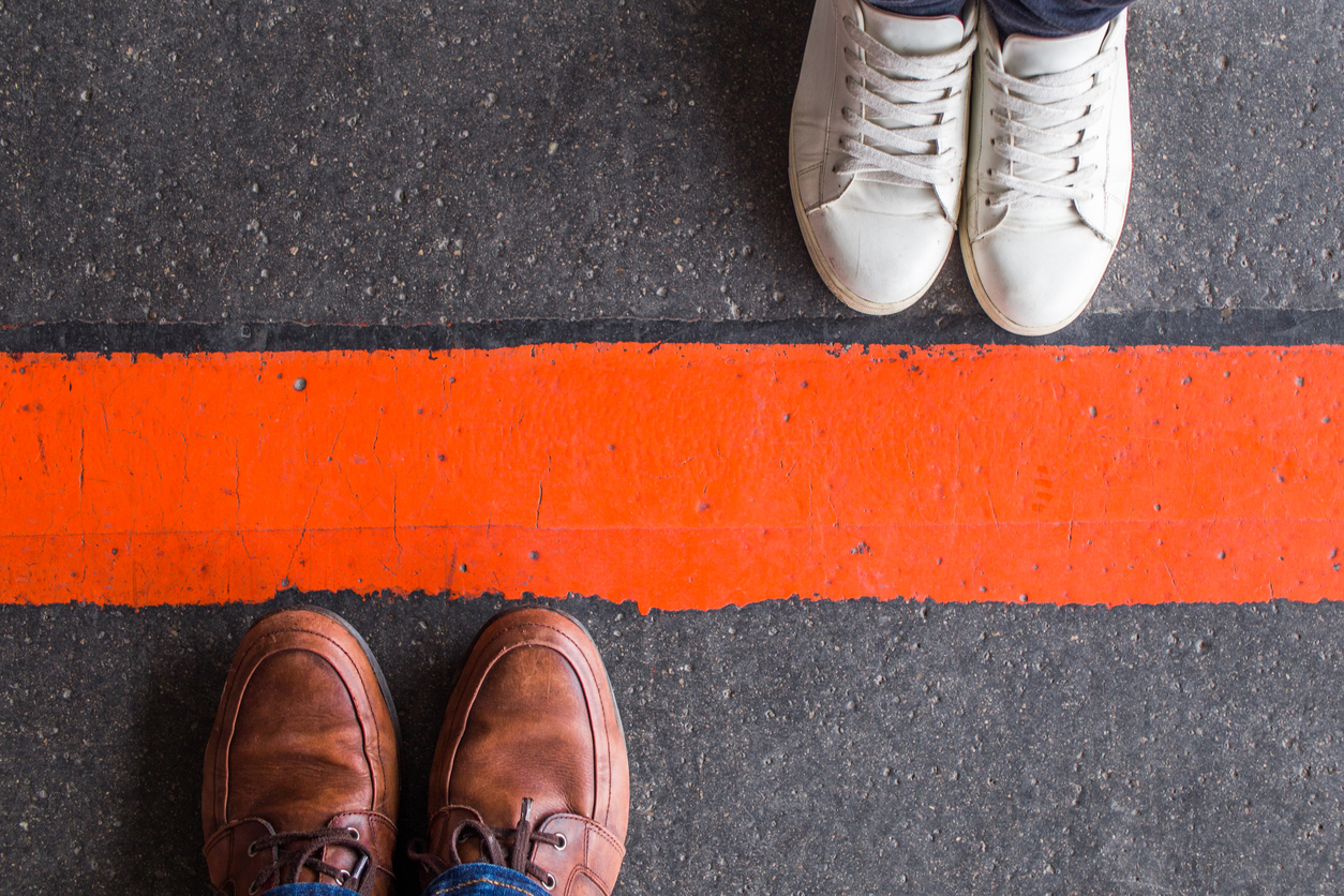 two pairs of opposing feet on either side of a red line